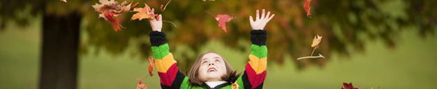 North Common Meadow: girl throwing fall leaves